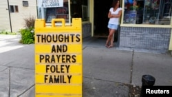 A sign outside a shop remembers James Foley in his hometown of Rochester, New Hampshire, Aug. 20, 2014.