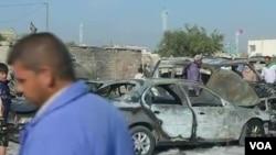 Hoton wata mota da bam ya fasa kennan a Iraqi.
