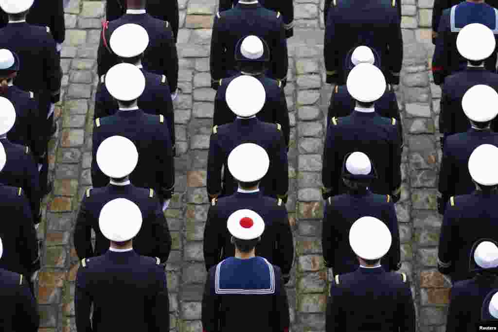French Navy sailors attend a ceremony in the courtyard of the Invalides in Paris.