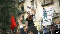 An Egyptian protester chants slogans against the country's military ruling council and presidential candidate Ahmed Shafiq in Tahrir Square in Cairo, Egypt, June 14, 2012.