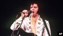 FILE - A 1973 photo shows Elvis Presley in concert.