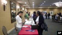 The U.S. economy added a solid 146,000 jobs in November and the unemployment rate fell to 7.7 percent, the lowest since December 2008, the Labor Department announced, Dec. 7, 2012.