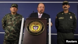 FILE - Colombia's Defense Minister Luis Carlos Villegas (C) delivers a speech during a news conference in Bogota, Oct. 26, 2015.