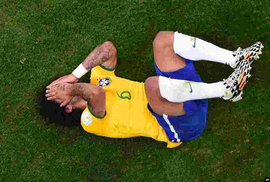 Brazil's Marcelo lies on the pitch during the World Cup semifinal soccer match between Brazil and Germany at the Mineirao Stadium in Belo Horizonte, Brazil, July 8, 2014.