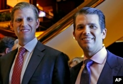 FILE - Eric Trump, left, and Donald Trump Jr., executive vice presidents of The Trump Organization, pose for a photograph at an event for Scion Hotels, a division of Trump hotels, in New York, June 5, 2017.