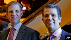 Eric Trump, left, and Donald Trump Jr., executive vice presidents of The Trump Organization, pose for a photograph at an event for Scion Hotels, a division of Trump hotels, June 5, 2017, in New York.
