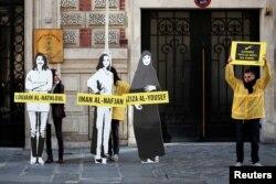 Uluslararası Af Örgütü üyeleri Dünya Kadınlar Günü'nde Hazlul'un serbest bırakılması için ABD'de Suudi Arabistan Büyükelçiliği önünde eylem yapmışlardı.