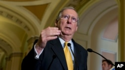 Senate Minority Leader Mitch McConnell of Ky. gestures during a news conference on Capitol Hill in Washington, May 21, 2013.
