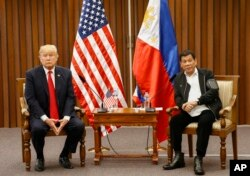 FILE - U.S. President Donald Trump, left, and Philippine President Rodrigo Duterte hold a bilateral meeting on the sidelines of the 31st ASEAN Summit at the Philippine International Convention Center in Manila, Philippines. Nov. 13, 2017.