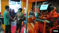 Bangladesh garment factories are starting to install fire extinguishers and hydrant systems after deadly industrial disasters. A fire safety expo featured pumps and other gear. (Amy Yee for VOA)