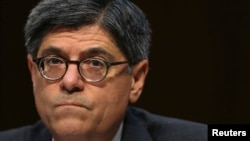 FILE - US Treasury Secretary Jack Lew testifies before the Senate Finance Committee on the US government debt limit in Washington.