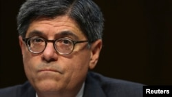 FILE - U.S. Treasury Secretary Jack Lew testifies before the Senate Finance Committee on the U.S. government debt limit in Washington, Oct. 10, 2013.