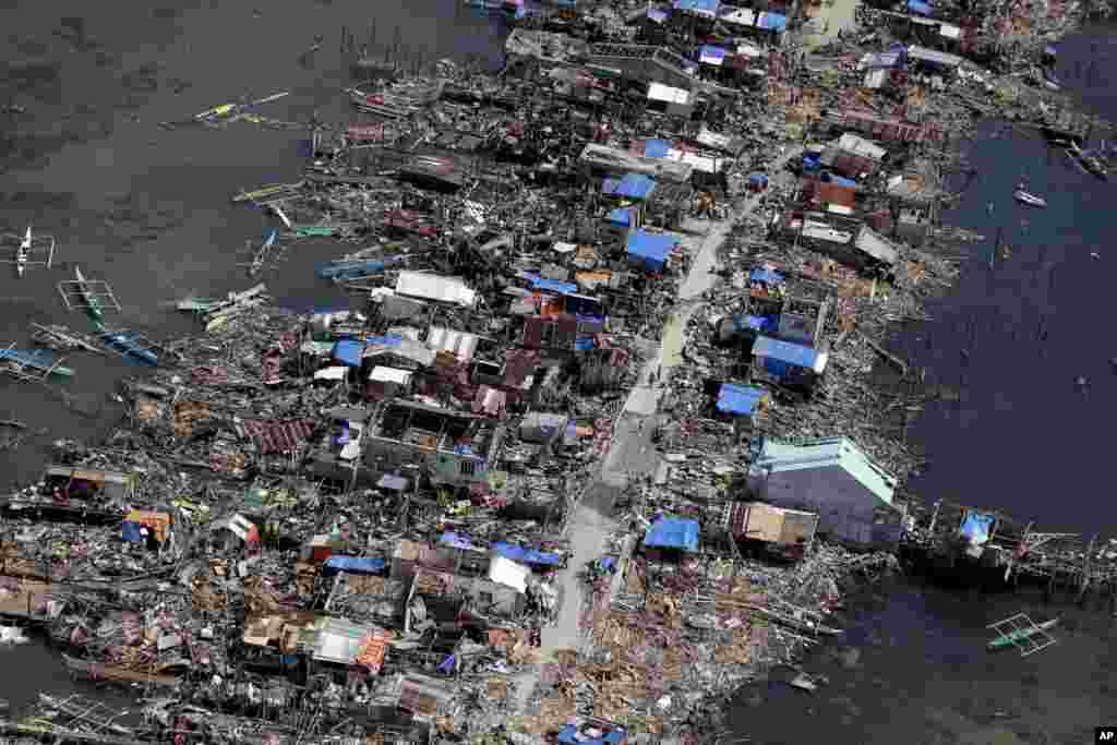 An aerial image taken from a Philippine Air Force helicopter shows the devastation of the first landfall by typhoon Haiyan in Guiuan, Eastern Samar province, central Philippines, Nov. 11, 2013.