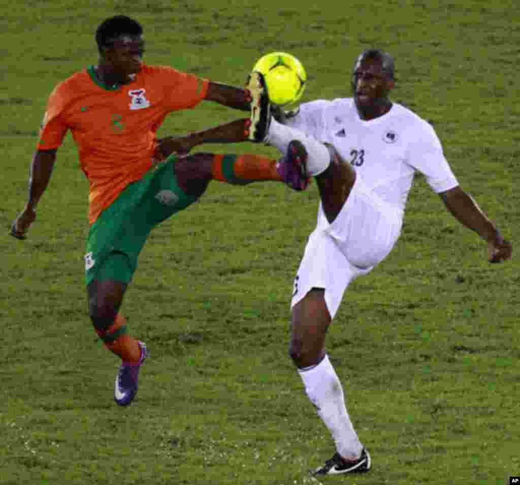 Stophira Sunzu of Zambia (L) challenges Ahmed Zuway of Libya during their African Nations Cup Group A soccer match at Bata Stadium in Bata