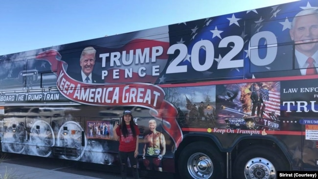 Sirirat, a 42-year-old Thai woman who supports President Donald Trump's candidacy, participates in Trump Train 2020 Campaign Tour in Scottsdale, Arizona on October 3, 2020