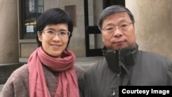 Lu Guang is shown with his wife, Xu Xiaoli, in an undated photo.