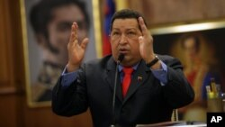 Venezuela's President Hugo Chavez talks during a press conference at Miraflores palace in Caracas, October 9, 2012.
