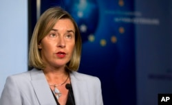 FILE - European Union foreign policy chief Federica Mogherini speaks during a media conference after a meeting of the EU3 and Iran at EEAS headquarters in Brussels, Jan. 11, 2018.