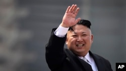 FILE - North Korean leader Kim Jong Un waves during a military parade in Pyongyang, North Korea, to celebrate the 105th birth anniversary of Kim Il Sung, the country's late founder and grandfather of current ruler, April 15, 2017.