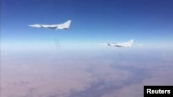 A still image taken from a video footage and released by Russia's Defence Ministry on January 24, 2017, shows Russian Tupolev Tu-22M3 long-range bombers dropping off bombs on what Defense Ministry said Islamic State targets in Deir al-Zor province, Syria.