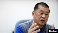 FILE - Jimmy Lai, chairman and founder of Next Media, speaks during an exclusive interview with Reuters in Taipei.