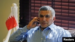 FILE - Bahrain human rights activist Nabeel Rajab is seen talking on his mobile phone.