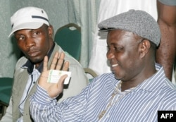 FILE - Tom Ateke, one of Nigeria's key militant leaders, speaks with Government Ekpemupolo known as Tompolo (L), commander of the rebel Movement for the Emancipation of the Niger Delta (MEND), during their meeting in Abuja, Oct. 9, 2009.