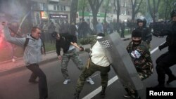 Pro-Russia and pro-Ukraine supporters are seen clashing in Donetsk, eastern Ukraine, April 28, 2014.