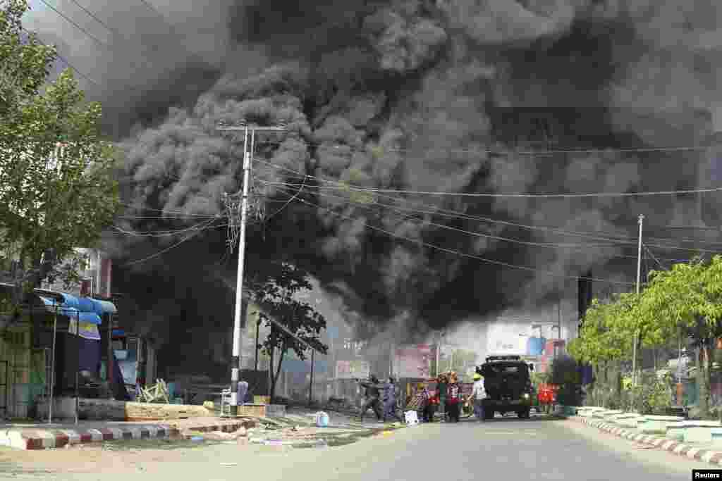 Firemen attempt to extinguish fires during riots in Meikhtila March 22, 2013.