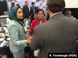 Sarwat Husain (left, in a green jacket) at the AMDC Luncheon at the Pennsylvania Convention Center during the Democratic National Convention.
