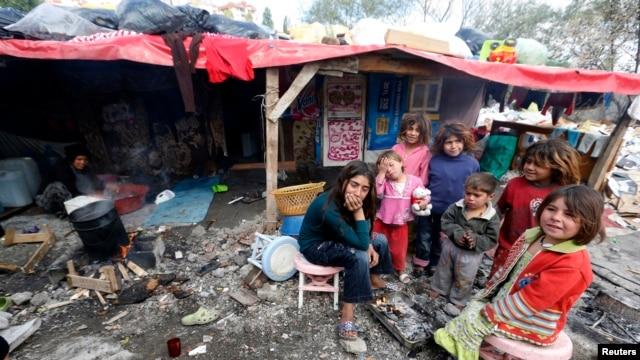 Syrian refugee children gather around fire near makeshift tents, central Ankara, Oct. 5, 2013.