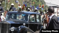 President Robert Mugabe being driven in the traditional limmousine at the official opening ceremony