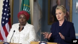 Secretary of State Hillary Rodham Clinton speaks to the media as African Union Chairperson Nkosazana Dlamini-Zuma, listens after their meeting in Washington, November 28, 2012.