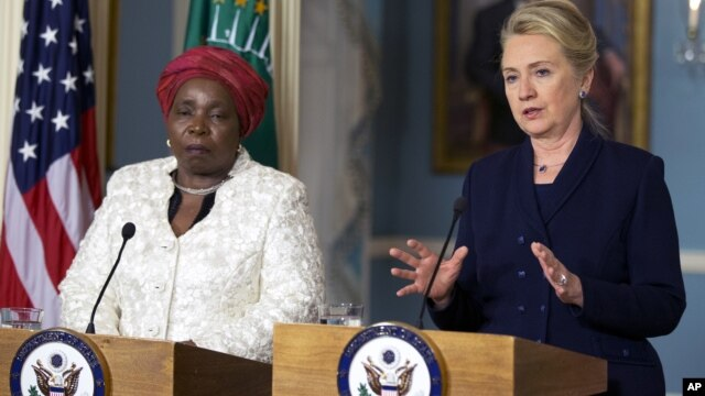 Secretary of State Hillary Rodham Clinton speaks to the media as African Union Chairperson Nkosazana Dlamini-Zuma, left, listens after their meeting at the Department of State in Washington, Wednesday, Nov. 28, 2012.