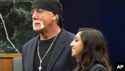 FILE - Former professional wrestler Hulk Hogan, left, stands with attorney Seema Ghatnekar, in a courtroom in St. Petersburg, Fla., March 18, 2016. A jury awarded Hogan $115 million in an invasion of privacy case against Gawker Media.