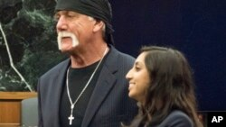 Former professional wrestler Hulk Hogan, left, stands with attorney Seema Ghatnekar, in a courtroom in St. Petersburg, Fla., March 18, 2016. A jury awarded Hogan $115 million in an invasion of privacy case against Gawker Media.