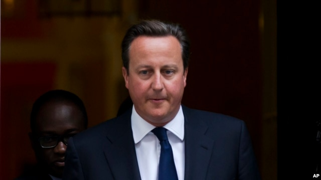 FILE - Britain's Prime Minister David Cameron leaves 10 Downing Street in London.