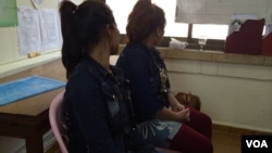 Uol Sreykhuoch, 32, and Horn Neang, 25, were in Malaysia as maids, at Adhoc headquarters in Phnom Penh on March 2, 2016, after their arrival in Cambodia. (Phorn Bopha/VOA Khmer)