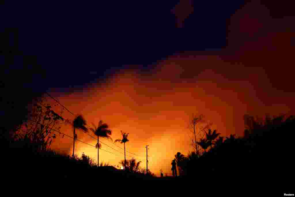The night sky is illuminated by lava pouring from a fissure eruption of the Kilauea Volcano in the Leilani Estates near Pahoa, Hawaii.