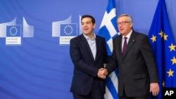 4일 벨기에 브뤼셀에서 알렉시스 치프라스 그리스 신임 총리(왼쪽)가 장 클로드 융커 유럽연합 상임위원장을 만났다.