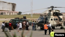 A Kenya Air Force helicopter transports the bodies of Ugandan Army personnel who died in a helicopter crash on Mount Kenya on Sunday is parked on the tarmac at Wilson Airport in Nairobi, Kenya, August 15, 2012