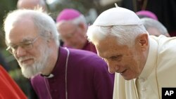 Pope Benedict XVI arrives with Archbishop of Canterbury Rowan Williams, left, to celebrate Vespers at Rome's San Gregorio al Celio Basilica, March 10, 2012.