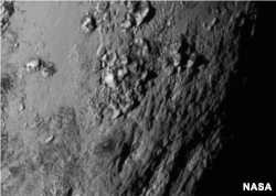 NASA reveals new close-up images of a region near Pluto's equator reveal a giant surprise: a range of youthful mountains, July 15, 2015.