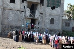Students gather for a morning drills outside of the teacher's house, who turned it into a makeshift free school, in Taiz, Yemen, Oct. 18, 2018.