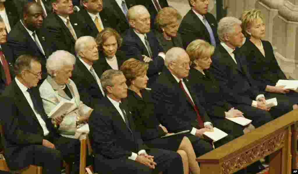Former President George W. Bush sits with former presidents and their wives during funeral services at the National Cathedral in Washington on June 10, 2004 for former President Ronald Reagan.