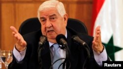Syria's Foreign Minister Walid al-Muallem speaks during a news conference in Damascus, Syria, Aug. 27, 2013.