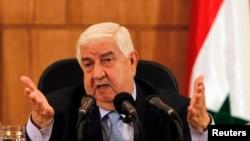 2013年8月27日叙利亚外长瓦利德•阿尔-穆阿利姆在大马士革举行的记者会上发表讲话。