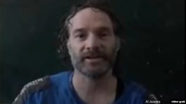 Journalist Peter Theo Curtis is shown in this image from a video obtained by Al Jazeera.