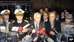 Istanbul Gov. Huseyin Avni Mutlu, center, speaks to the media after a commando raid in the Sea of Marmara, west of Istanbul, Turkey, early Saturday, Nov. 12, 2011.