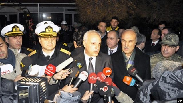 Istanbul Gov. Huseyin Avni Mutlu, center, speaks to the media after a commando raid in the Sea of Marmara, west of Istanbul, Turkey, early Saturday, Nov. 12, 2011.